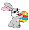 Cute rabbit holding ester egg vector image