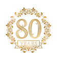 Golden emblem of eightieth years anniversary in vector image
