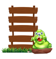 A monster above the rock beside the empty wooden vector image vector image