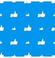 Thumbs up white icons on blue seamless pattern vector image