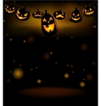 The hanging laughing Halloween lanterns vector image vector image