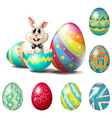 A happy bunny with colorful eggs vector image vector image