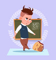 small bad school boy standing over class board vector image