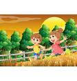 Kids playing at the forest near the wooden fence vector image