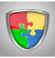 Shield with puzzle pieces vector image vector image