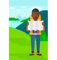 Backpacker looking at map vector image vector image