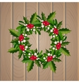 Christmas mistletoe wreath on wooden background vector image