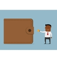 Businessman brings money to the wallet vector image