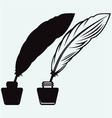 Ancient pen and inkwell vector image