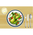 Garnished salad on a wooden table vector image vector image