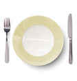 empty plate with ivory-colored design with knife vector image