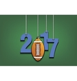 Football and 2017 hanging on strings vector image