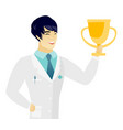 young asian doctor holding a golden trophy vector image
