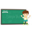 Little boy standing by the blackboard vector image