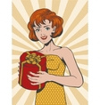 Red haired Girl in retro style holding gift box vector image