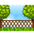 Garden scene with fence and trees vector image