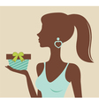 Woman holding gift vector image