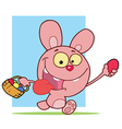 Pink Bunny Holding Up An Easter Egg And Carrying A vector image