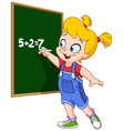 girl writing on blackboard vector image