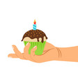 hand holding cupcake with candle vector image