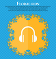 headphones icon Floral flat design on a blue vector image