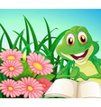 A frog with a book at the garden vector image