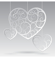 Paper suspended patterned hearts vector image vector image