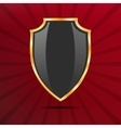 Metallic black golden shield on red background vector image