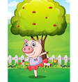 A female pig playing at the yard near the big tree vector image vector image