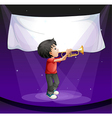 A boy performing at the stage with an empty banner vector image vector image