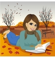 woman reading a book in autumn park vector image