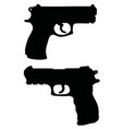 black silhouettes of handguns vector image