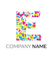 letter e logo with blue yellow red particles vector image