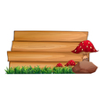 Wooden signboards at the back of the mushrooms vector image