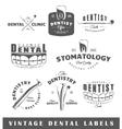 Set of vintage dentist labels vector image