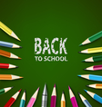 Back to school with colored pencils on green vector image