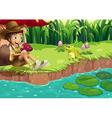 A boy and a frog at the riverbank vector image