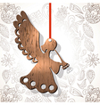 Wooden figure of angel vector image vector image