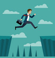 businessman jumping over between the cliffs vector image