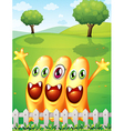 Three happy orange monster near the fence vector image vector image