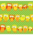 Seamless pattern with cute owls on green dotted vector image