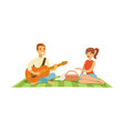 young man playing guitar to his girl on a picnic vector image