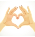 Heart folded of beautiful female hands isolated on vector image