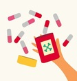 A hand holding pills vector image