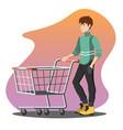 young man pushing a shopping empty cart vector image