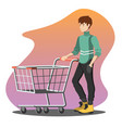 young man pushing a shopping empty cart vector image
