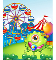 A young one-eyed monster holding a balloon near vector image vector image