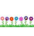Seamless grass and flowers vector image