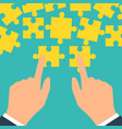 teamwork concept puzzle holding in hands vector image