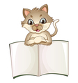 A brown cat opening an empty notebook vector image vector image